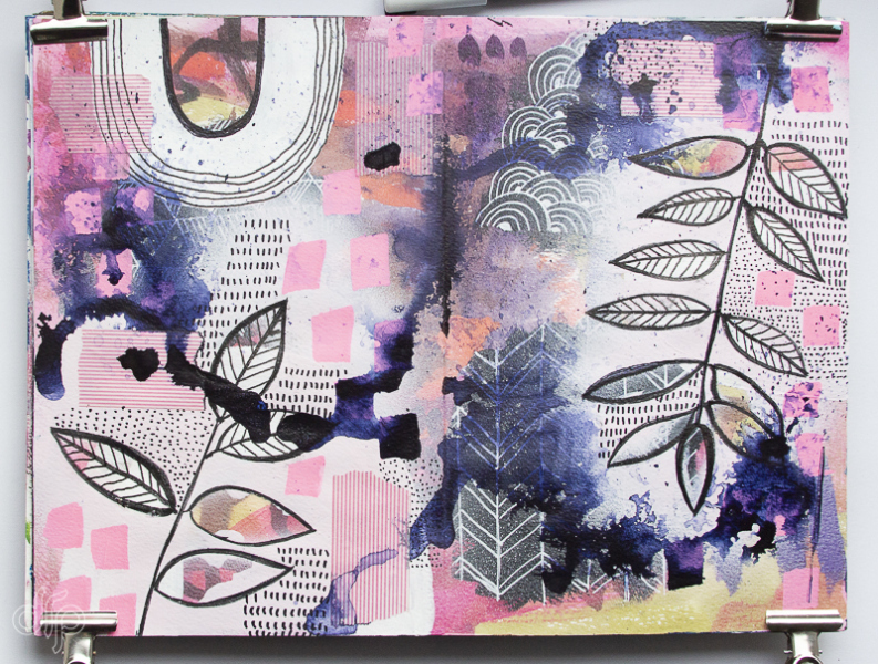 Art journal spread with painted leaves and drips