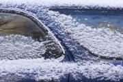 snow on blue car