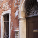 decaying orange facade in Venice