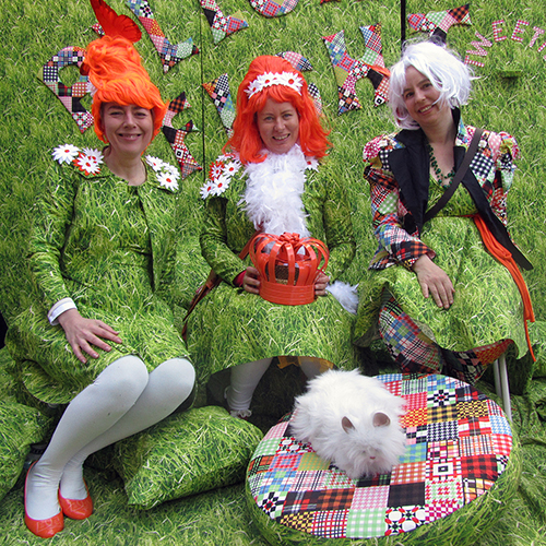 three of us in grass suits