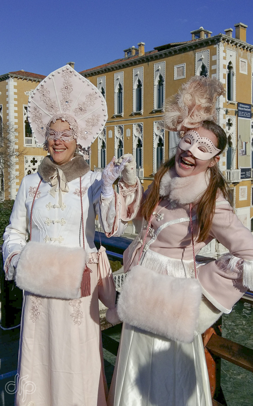 Two girlfriends in costume on Ponte dell'Accademia