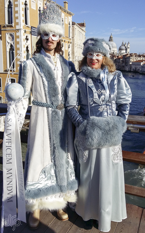 Two friends in matching costumes on Ponte dell'Accademia