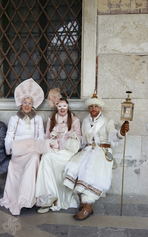 Three of us in pink and white costumes on San Marco square