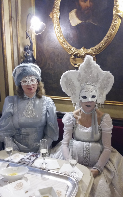 Two of us in costume in Caffe Florian, San Marco square Venice, Italy