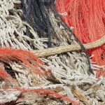 black and orange ropes with fishing nets