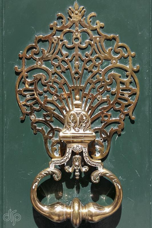 Intricate pattern of a door knocker in Paris, France